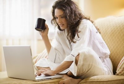 Woman working at home with laptop computer